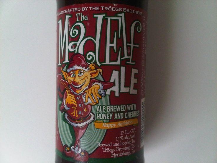 Cerveja Troegs Mad Elf Ale, estilo Belgian Dark Strong Ale, produzida por Tröegs Brewing Company, Estados Unidos. 11% ABV de álcool.
