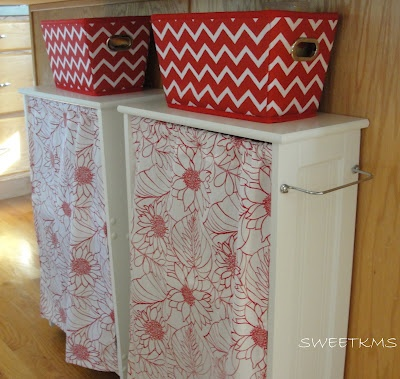 The curtains for these cupboards are made from tea towels and hung from a tension rod.