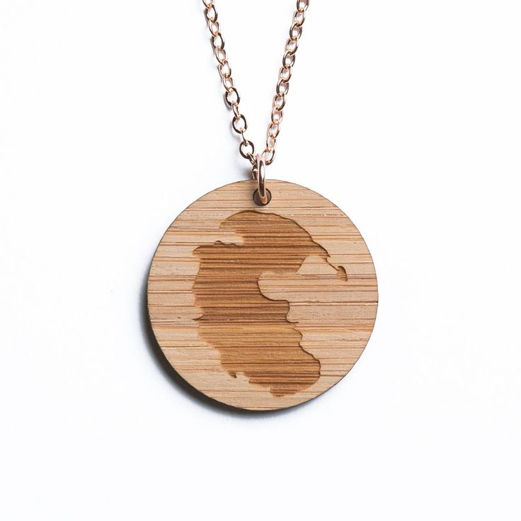 Pangea map necklace, etched into eco-friendly FSC certified bamboo (using a laser burner), on a recycled rose gold plated sterling silver chain.