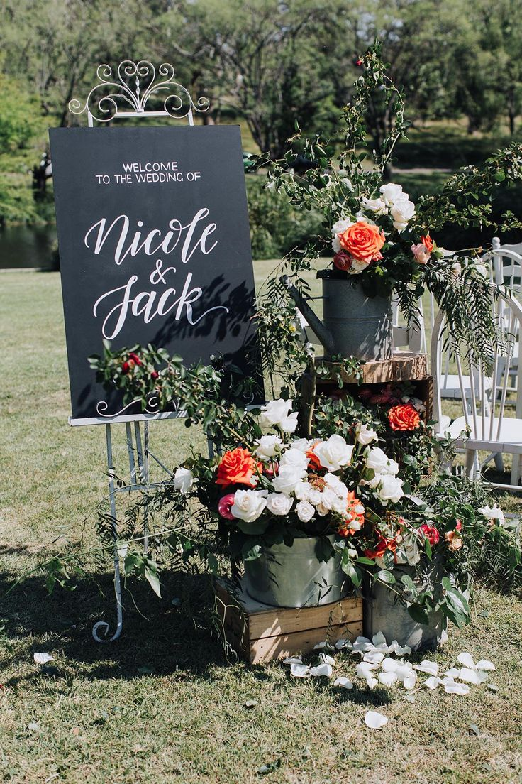 Ceremony welcome sign. Photographer: @rachel_takes_pictures | Flowers & styling: @visually_creative #sydneywedding #ceremony #centennialparkwedding #weddingstylist #floralstylist #chalkboardsign #decorhire #flowers #ramblingflowers #orangeandwhiteflowers
