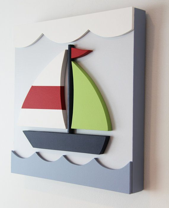 3D Nautical wood sailboat wall art for 79.00 plus shipping {15.00} The boat and sails are bright green,red, and navy on a pale blue background with white clouds and medium blue waves. The finished artwork measures 14 inches wide by 14 inches tall and extends approximately 2 inches from the wall.