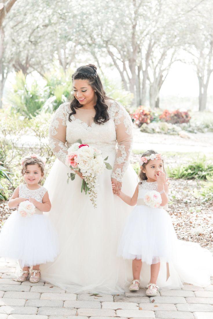 aabbe635dd Orlando wedding at Mystic dunes resort. Bride with cute flower girls at  garden wedding