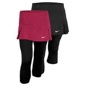 The Nike Women's Dri-FIT Tennis Tight  is made from a compression fabric that allows for a great fit and high levels of comfort, and the Dri-FITtechnology keeps you dry. A side pocket for ball storage and a power mesh waistband provide practical storage and comfort. A woven skirt at the waistband adds a fun, flirty look to these warm and comfy tights.Technical Benefits: Dri-FITFabric: 84% Polyester / 16% Spandex TaffetaFor information regarding sizes, please refer to our sizing chart.
