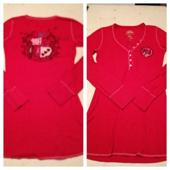 """NWOT Victorias Secret Red Long Sleeved Top size XS NWOT Victorias Secret red long John style long sleeved top with great print on left breast and back with button neckline accent approximately 30"""" long from neckline to hem at the back of shirt Victoria's Secret Tops"""