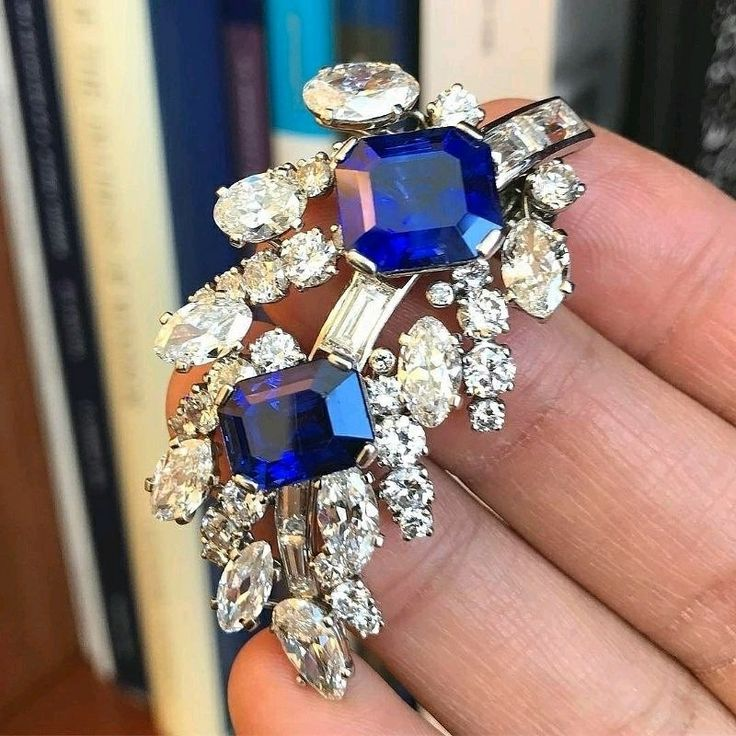 Cartier platinum, sapphire and diamond brooch circa 1930's.  This piece was owned by Mrs. John Rovensky, formally Mrs. Morton Plant, who traded her 5th Avenue Mansion to Cartier for a double strand natural pearl necklace valued at $1M in 1917.  The mansion still stands today and is the flagship store for Cartier at 5th Ave and 52nd Street.
