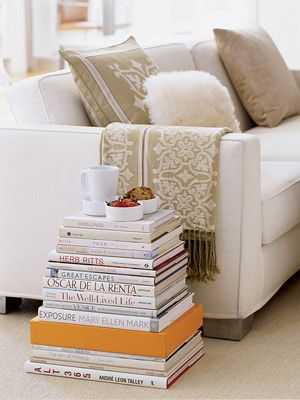 Don't display paperbacks when decorating with books.    When creating decorative vignettes that include books, stick to hardcovers. Remove the dust jackets to show binding color, embossing and texture. Display books on the coffee table, place them on side tables with knickknacks on top or neatly stack them right on the floor next to your sofa.