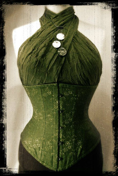 Green cotton brocade under-bust corset. The top worn in the picture is only a long scarf that has been wrapped to look like a halterneck top. By Anette Fredsdatter Heidal.