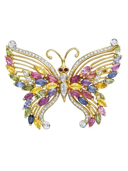A Butterfly Brooch   Designed as a butterfly, centering on a pavé-set diamond body, extending marquise-cut multi-color sapphire wings, to the collet-set ruby eyes, mounted in 18K yellow gold, length 2 inches.   no.883 D070  Estimate $1,000 - 2,000     Sold for $3,750