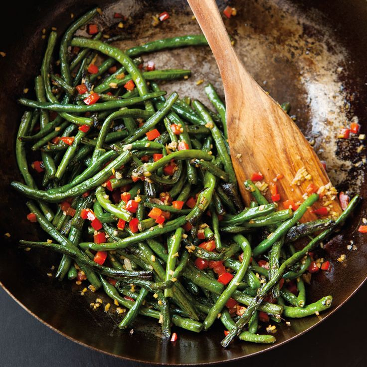For this Chinese dry-fried long beans recipe, cut beans and cook them in a hot wok until the skins wrinkle and brown in spots before adding any seasonings.