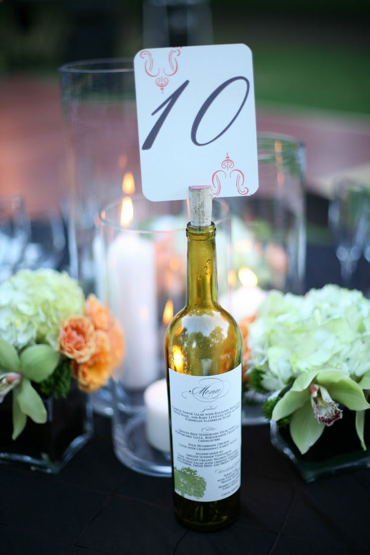 Wine bottle table numbers and menu pasted to the bottle! Cute if we get married in the vineyard like we want :) (Someday, @Tracey Deming :) )