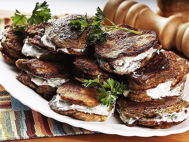 Liver pancakes with sour cream sauce