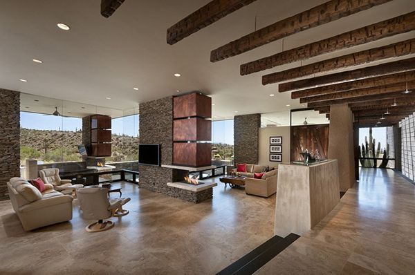 Arizona desert house interior, excellent use of concrete, beams and copper, very warm yet cool creation.  Contemporary marvel