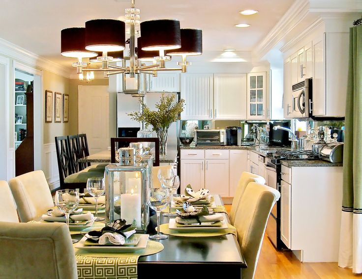 Interior Open Floor Plan Kitchen Dining Living Room Chandeliers Lamp Shades White Cabinets