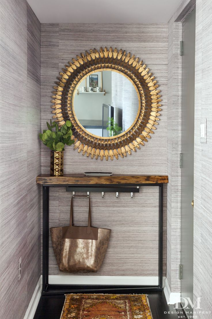 Entryway with gold mirror and Scalamandre Haiku grasscloth wallpaper in Dogwood by Design Manifest