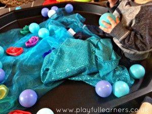 Sensory play in an active world tuff spot tray.