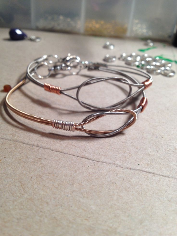 My newest monsters!   Guitar string bracelets.