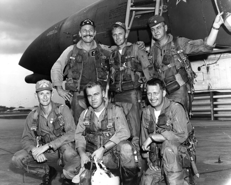 """USAF 8th TFW CO Colonel Robin Olds with 555th TFS Pilots, Vietnam, May 4th, 1967 [Robin Olds (July 14, 1922 – June 14, 2007) was an American fighter pilot and general officer in the U.S. Air Force. He was a """"triple ace"""", with a combined total of 16 victories in World War II and the Vietnam War. He retired in 1973 as a brigadier general. In addition, in 1985 he was enshrined in the College Football Hall of Fame for his All-American football career as an Offensive & Defensive Tackle at West…"""