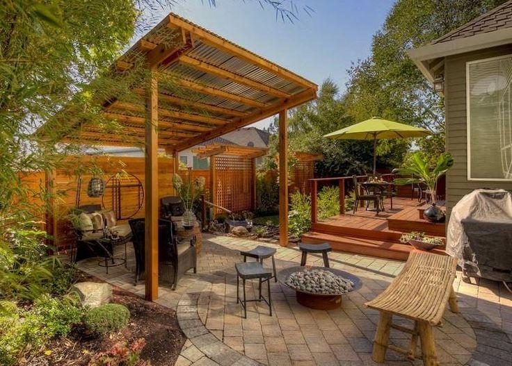 pergola adossée en bois massif, banc en bois exotique, sol en pierre et foyer extérieur