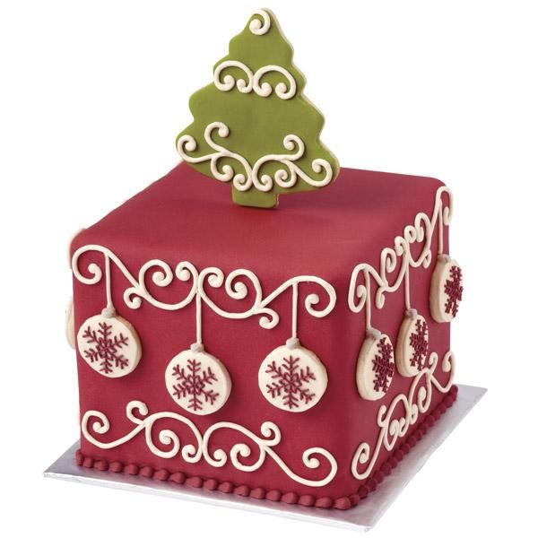 Christmas Cake.  fondant with scroll work and Christmas ornaments on the sides.  Topped with a Christmas cookie