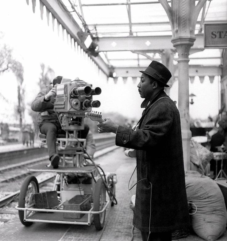 Muddy Waters outdoor concert at a train station in Manchester May 7th,1964. Muddy played on one side and the audience was on the other!