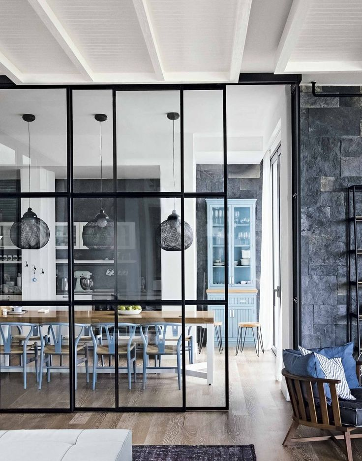Gorgeous floor to ceiling glass divider between kitchen dining room and living room