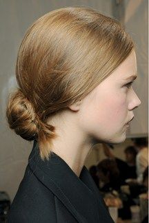 Spring Summer 2013 Hair Trends: ANTI-BALLERINA BUNS - There were plenty of buns being created backstage at the shows, but barely any of them had that slicked-back, ballerina sensibility we so associate with the style. Instead, at Valentino, Erdem and Ralph Lauren they were paired with side partings, whilst at Matthew Williamson and Bottega Veneta they were messier and centre-parted, as if the models had done them themselves.