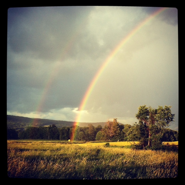 A double rainbow touched down right in front of me just after a sudden summer storm.