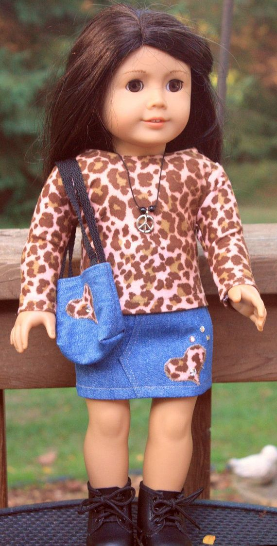 American Girl Doll Clothes-Faux Animal Print Long Sleeve shirt and Skirt. long sleeve T shirt of a faux animal print with back velcro closure, denim skirt with appliqued heart embellished with set in rhinestones, lined totebag with matching applique and necklace. The necklace is strung on jewelry elastic. The skirt is top stitched with elastic at the waist. Liberty Jane Pattern used. Item sold on Etsy.