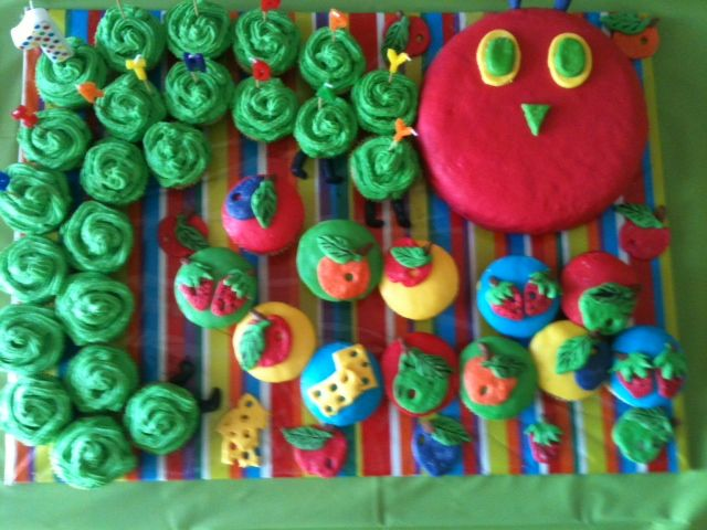 "Very Hungry Caterpillar Cake - for twin's 1st birthday - Happy Birthday Elijah and Isaiah. Fondant ""face"" and cupcake decorations.  Tinted sweetened fresh cream on green cupcakes."