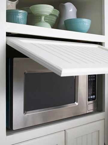 Give your kitchen a cleaner look by concealing the microwave. This microwave fits into a cubby, and a slide-back door makes it easily accessible without taking up a single inch of counter space.
