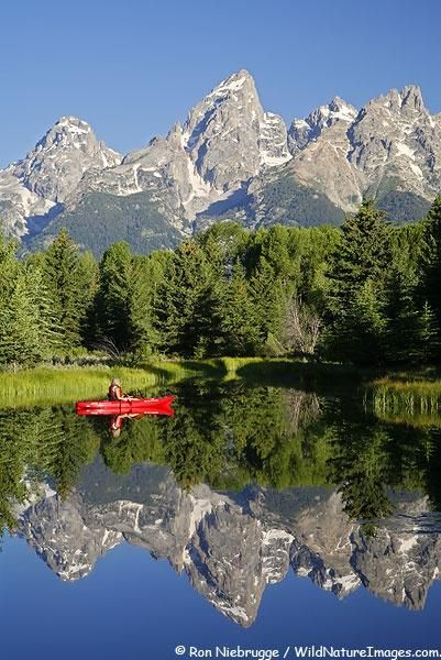 Grand Tetons-Wyoming. The Teton Range is a mountain range of the Rocky Mountains in North America. A north-south range, it is mostly on the Wyoming side of the state's border with Idaho, just south of Yellowstone National Park.