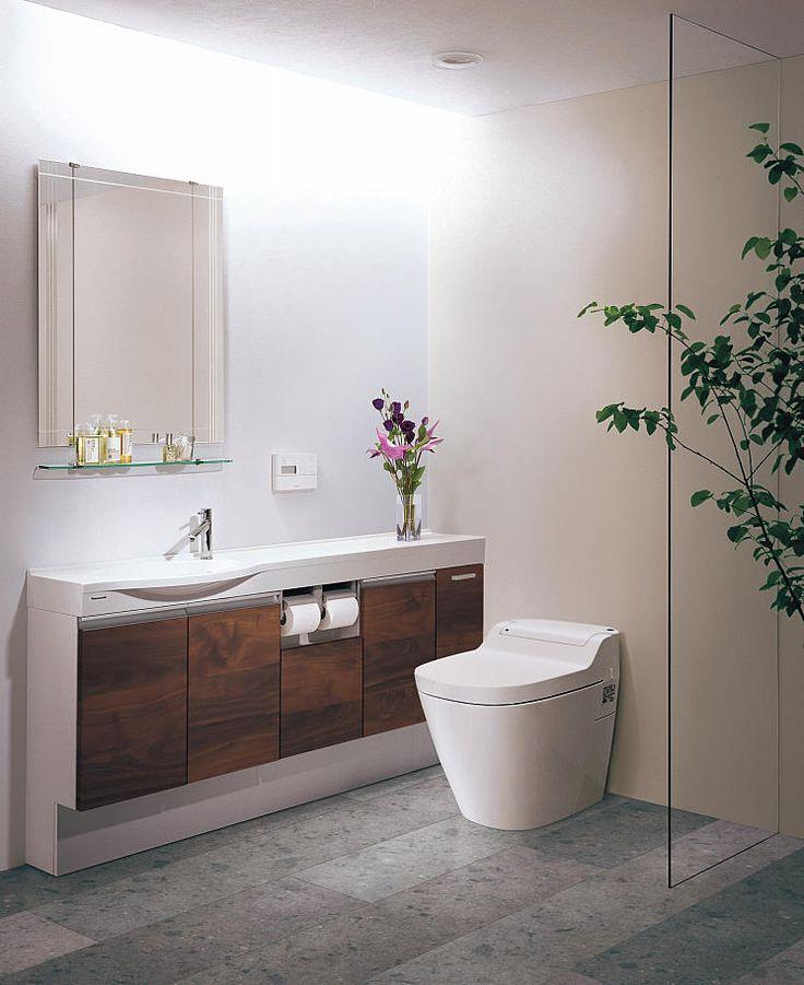 Panasonic トイレ:アラウーノ トイレカウンター:セレスタイル[ リアロウォールナット柄 ] 床:Archi-spec フロアA 石目柄 [ 芦野石柄(グレーストーン)]