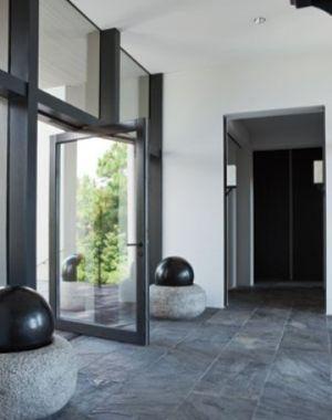braithwait-window-modern black door windows stone tile floor.jpg