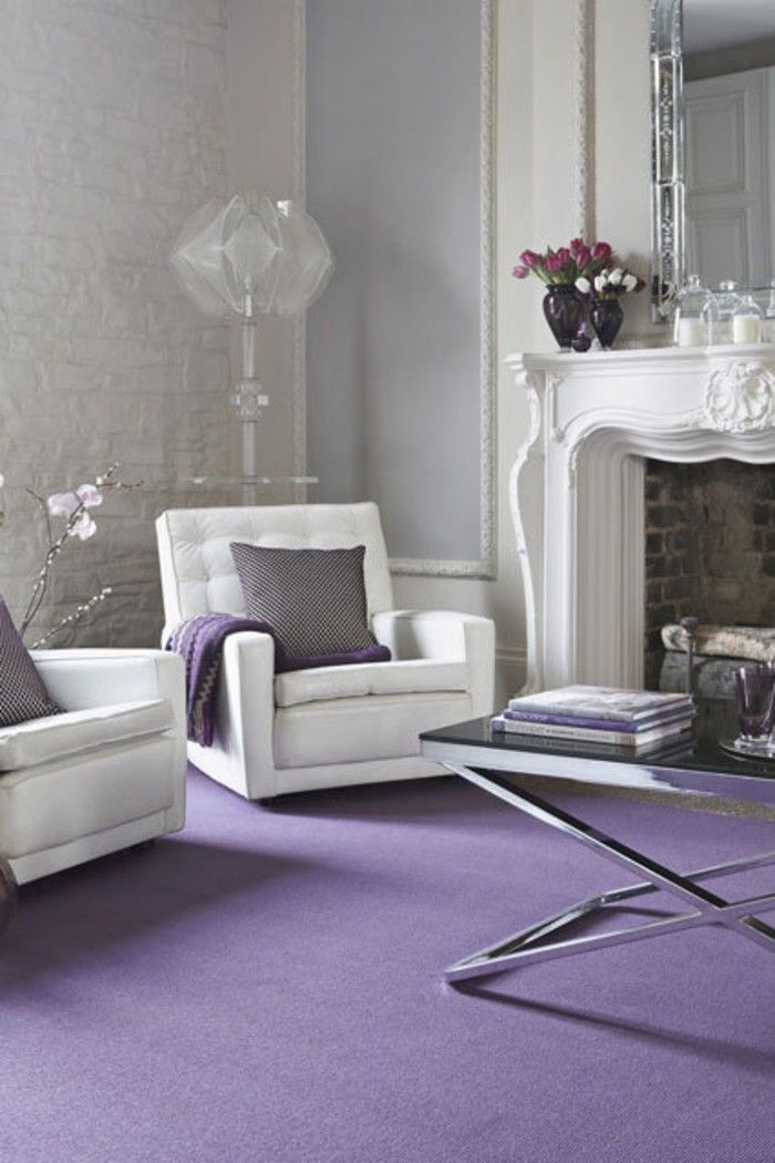 White living room furniture purple carpet.
