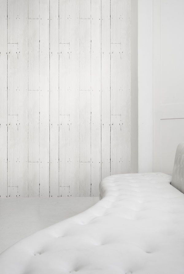 The White Planks wallpaper features painted white wooden planks with nail holes for a minimal shabby chic look. It can be used to create a bright contemporary feel reminicent of beach huts, magazine shoots and holiday homes.