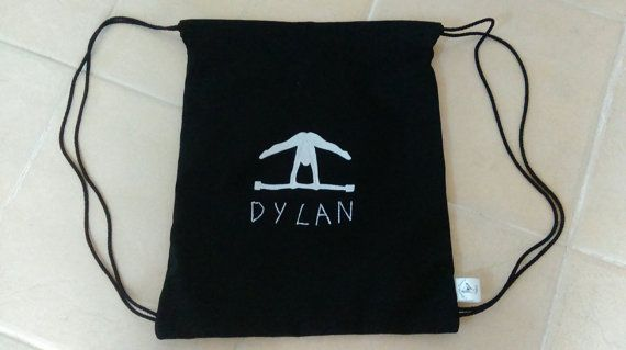 This simple gym bag will provide the perfect storage solution for all your gymnasts equipment. With a felt gymnast detail on the front and a plain back. The canvas bag can be closed by pulling the drawstring straps on either side of the bag. The bag can be personalised with a name displayed under the football detail. The bag measures 41 cm x 36 cm when laid flat not including the straps. To request a personalised name on the bag please message when ordering otherwise the item will be sent…