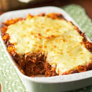 Instead of layering the ingredients, this lasagna recipe mixes the pasta and sauce together, then tops with cheese to cut prep time.