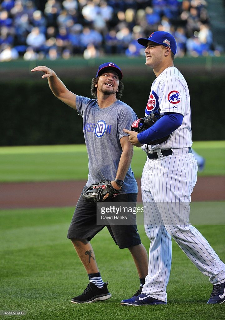 Eddie Vedder Lead Singer of Pearl Jam and Anthony Rizzo #44 of the Chicago Cubs after throwing out the ceremonial first pitch before the game between the Chicago Cubs and the San Diego Padres on July 24, 2014 at Wrigley Field in Chicago, Illinois.