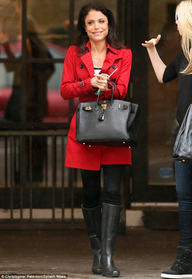 Bethenny Frankel... love the red trench coat, and the black wedged Wellies!!