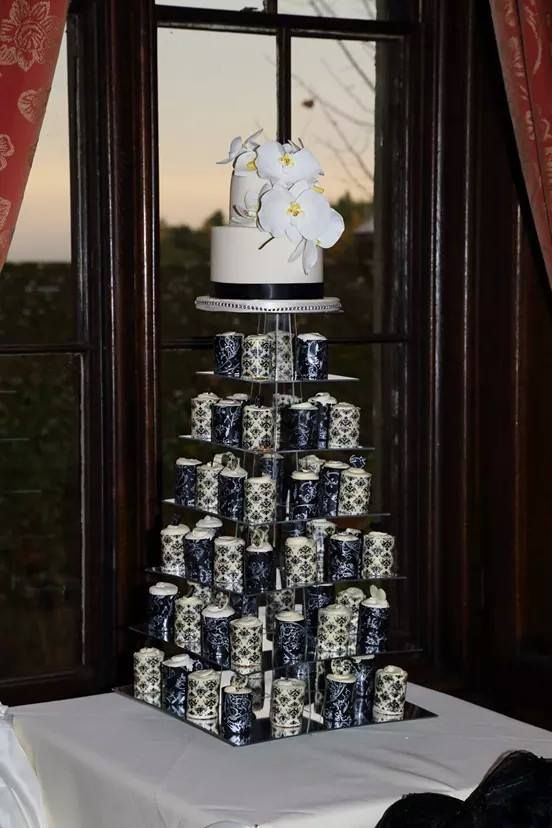 mini chocolate wedding cakes each cake was wrapped in white or dark chocolate wrapper with a buttercream swirl on top