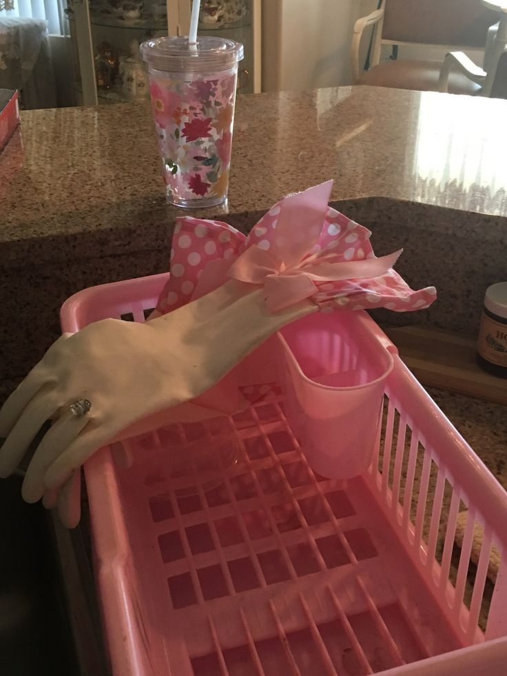Pink dish drainer and pink and white rubber gloves
