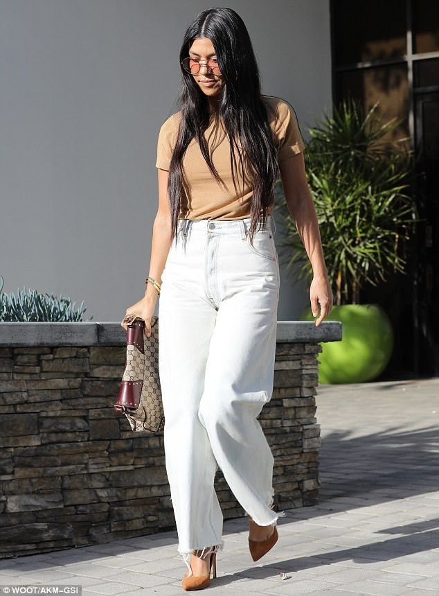 Kourt out! Kourtney Kardashian leaves studio in baggy white mom jeans #dailymail