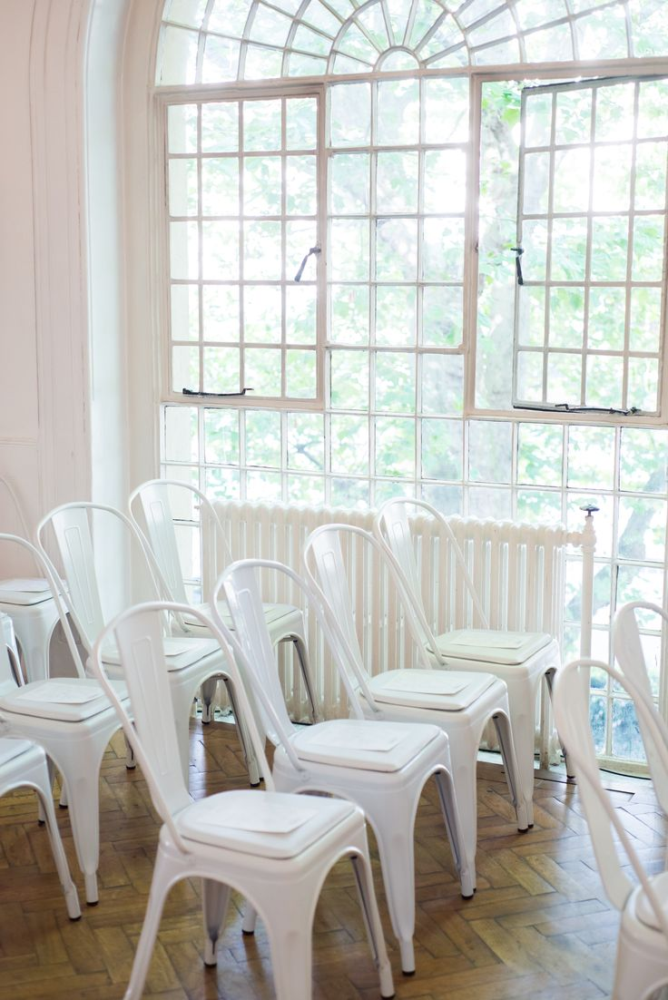 White button back sofa, Large square pouf table - One Marylebone  #eventfurniture #eventfurniturehire #papergirls #paperfest #onemarylebone #eventprofs #sofahire #whitefurniture #tolixchair #white tolix
