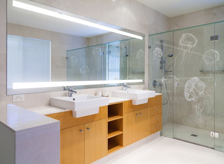 Luxury bathroom, complete with Equality Lighted Bathroom Mirror and Jellyfish Frosted Shower Screen. Designed and made by Clearlight Designs. http://clearlightdesigns.com.au/