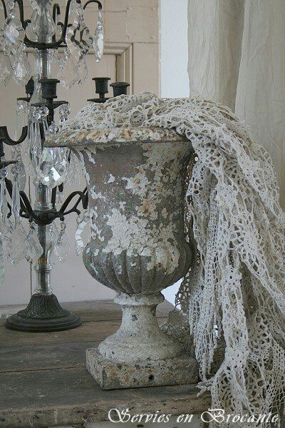 Urn overflowing with crocheted lace & doilies