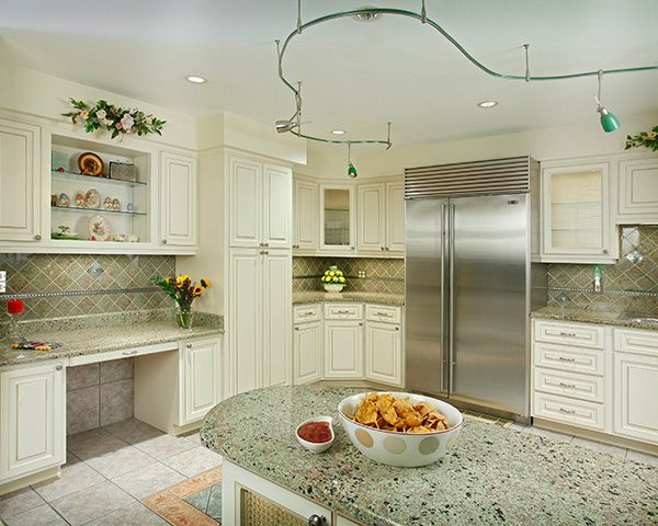 This Refaced Kitchen Features Antique White Cabinets With A Walnut Glaze.  This Popular Color Is