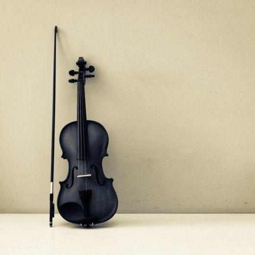 I think it's a violin (or a viola?).  I just think it looks beautiful, black.