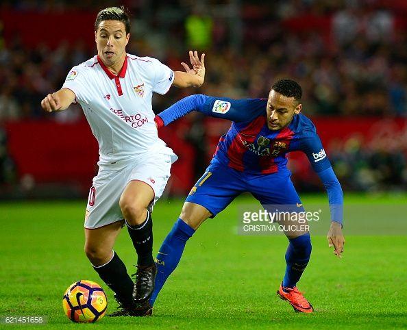 Sevilla's French midfielder Samir Nasri vies with Barcelona's Brazilian forward Neymar during the Spanish league football match Sevilla FC vs FC...