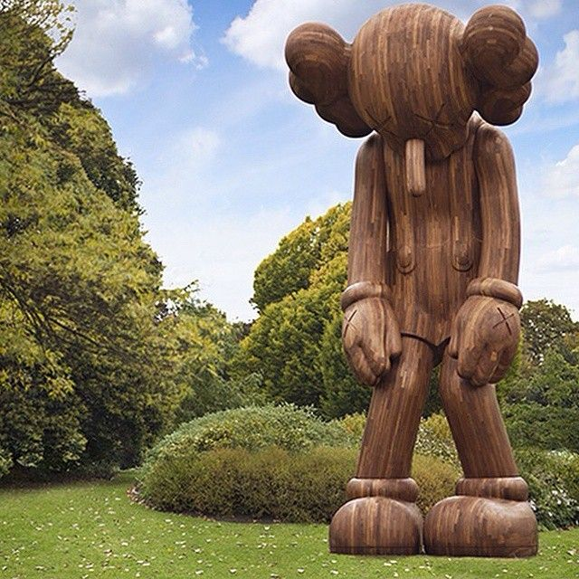 "Kaws ""Small Lie"" wooden statue this week at the Frieze Sculpture Park, Regent's Park. #kaws #smalllie #frieze #regentspark #woodencompanion"