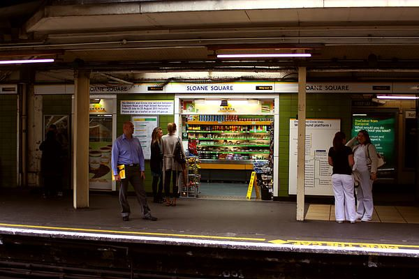 I was interested in how people were killing time before their tube train arrived. The light from the shop acts as a framed stage for the people acting out their lives.